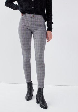SKINNY - Trousers - gris