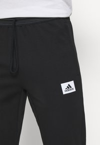 adidas Performance - AEROREADY TRAINING SPORTS PANTS - Teplákové kalhoty - black/white - 3