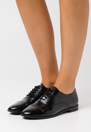 CARLEI - Lace-ups - black