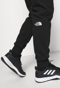 The North Face - MEDIUM - Tracksuit bottoms - black - 3