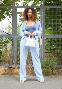Juicy Couture - NUMERAL TRACK PANTS - Joggebukse - powder blue - 1