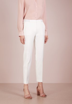 HEFENA - Trousers - natural