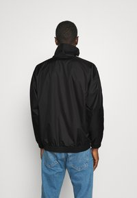 adidas Originals - UNISEX - Training jacket - black/white - 2