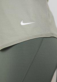 Nike Performance - DRY TANK ELASTIKA - Sports shirt - jade stone/white - 6