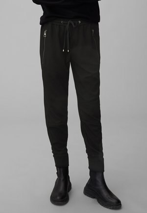 LONTTA - Tracksuit bottoms - black