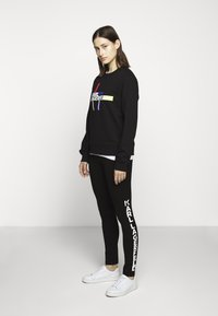 KARL LAGERFELD - PUNTO LOGO - Leggings - Trousers - black - 1