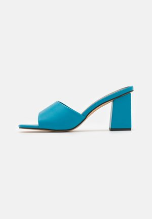 GOLDEN - Heeled mules - blue paris