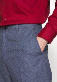Tommy Hilfiger Tailored - FLEX MICRO PRINT SLIM FIT PANT - Pantaloni - blue - 5