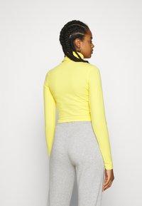 Ellesse - VORAN - Langærmede T-shirts - yellow - 2