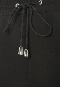 Filippa K - FIONA DRAPEY TROUSER - Kalhoty - black - 5