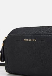 Forever New - LISA FRONT POCKET CROSSBODY BAG - Across body bag - black - 3