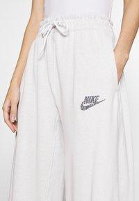 Nike Sportswear - Tracksuit bottoms - platinum tint - 4