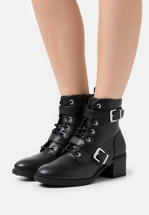 ANNIE - Lace-up ankle boots - black