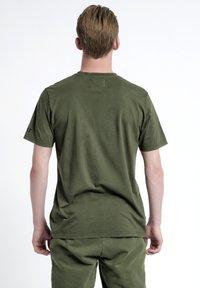 HALO - T-shirts print - olive night - 2