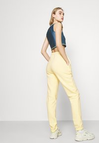 Nly by Nelly - COZY PANTS - Tracksuit bottoms - yellow - 4