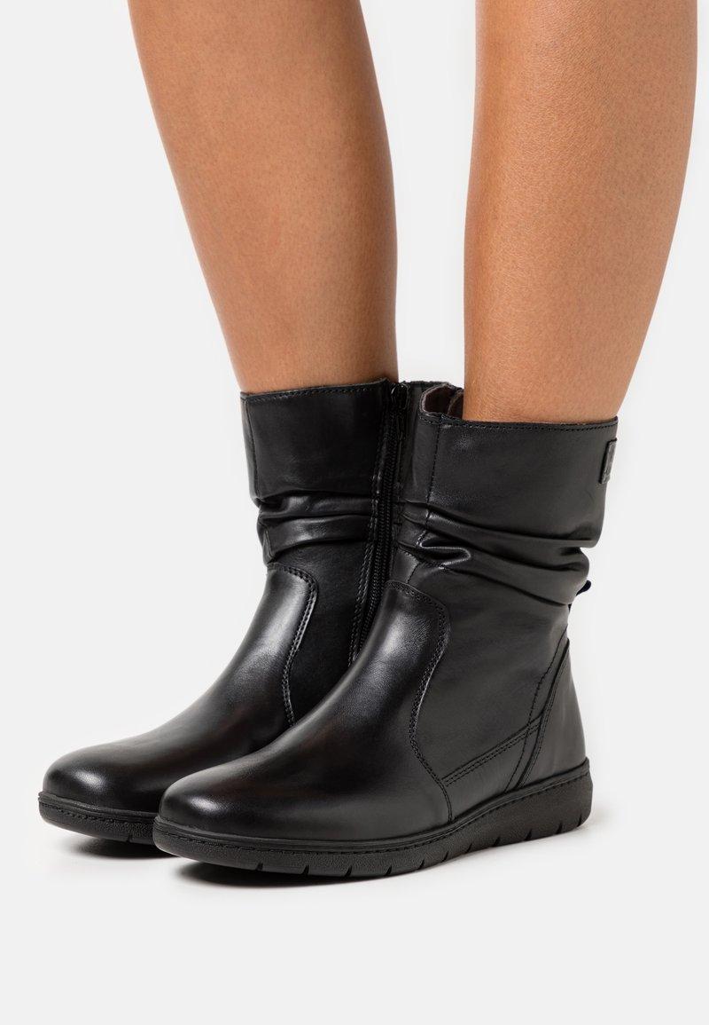 Jana - Kotníkové boty - black