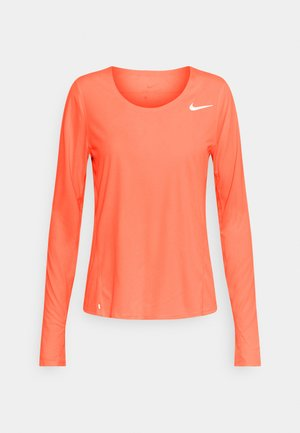 CITY SLEEK - Sports shirt - bright mango/silver