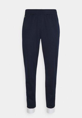 TENNIS PANT BLOCK - Pantaloni sportivi - navy blau/weiß