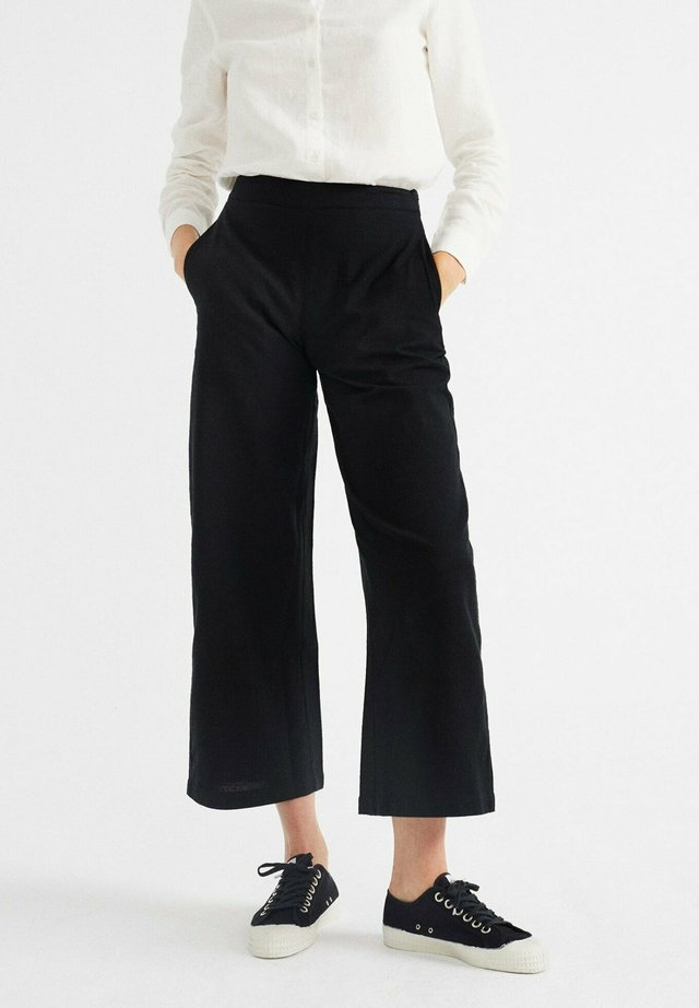 BEGONIA - Trousers - black