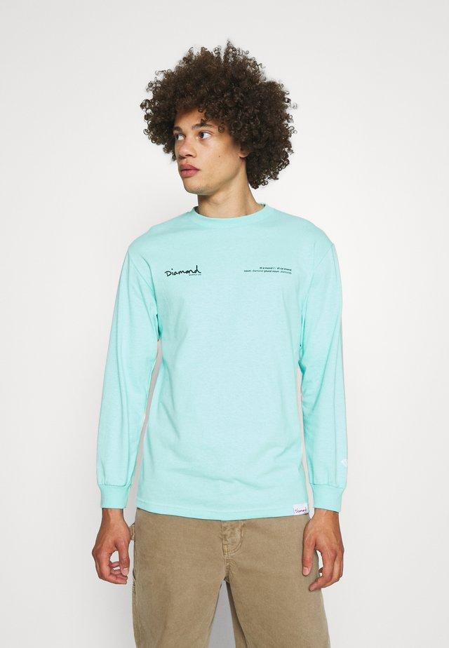 Long sleeved top - diamond blue