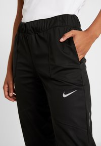 Nike Performance - SHIELD PROTECT PANT - Joggebukse - black/silver - 6