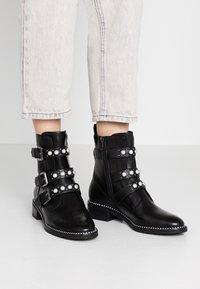 Tamaris - Cowboy/biker ankle boot - black - 0