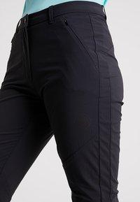 Mammut - HIKING PANTS WOMEN - Outdoor trousers - black - 4