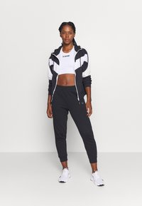 Calvin Klein Performance - PANTS - Tracksuit bottoms - black - 1