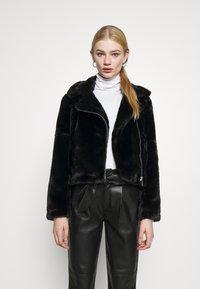 Vero Moda - VMTHEA BIKER JACKET - Winter jacket - black - 0