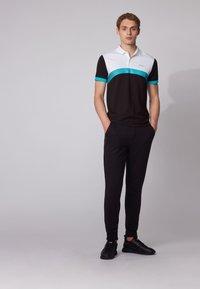 BOSS - PAULE  - Polo shirt - black - 1