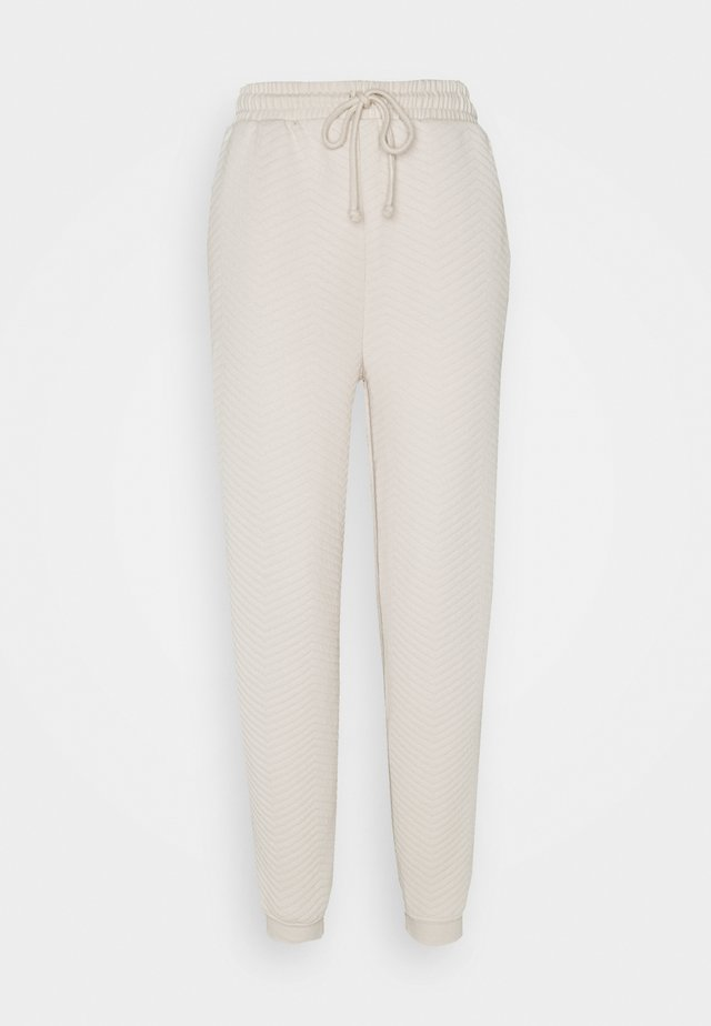 ZIG ZAG QUILTED  - Tracksuit bottoms - ecru