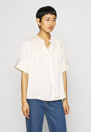 BLOUSE - Button-down blouse - beige dusty light