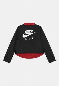 Nike Sportswear - AIR COACH  - Light jacket - black/university red/white - 1