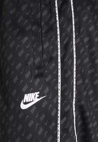 Nike Sportswear - REPEAT - Tracksuit bottoms - black/white - 6