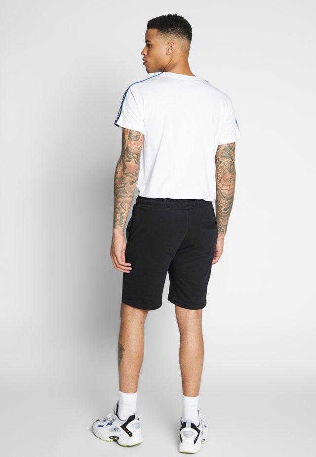 ELDON - Pantalones deportivos - black