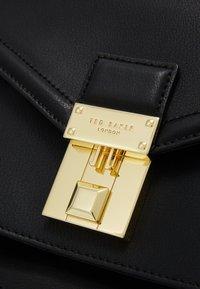 Ted Baker - KIMMIEE LUGGAGE LOCK MINI SATCHEL - Across body bag - black - 4