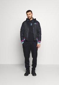 Nike Performance - NBA MIAMI HEAT CITY EDITION JACKET - Club wear - black - 1