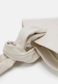 Little Liffner - SOFT LOOP MINI BUCKET - Handbag - off-white - 4