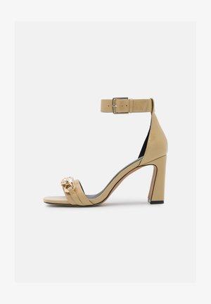VEGAN KAYLANI - High heeled sandals - dark yellow