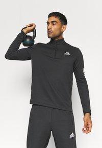 adidas Performance - 1/4 ZIP TRAINING WORKOUT AEROREADY PRIMEGREEN - Long sleeved top - black - 3