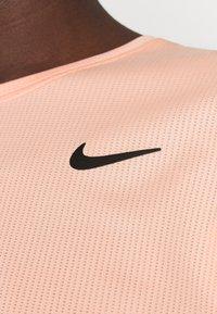 Nike Performance - T-shirts - arctic orange - 4