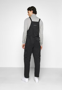 Nike Sportswear - OVERALLS - Stoffhose - black/white - 2