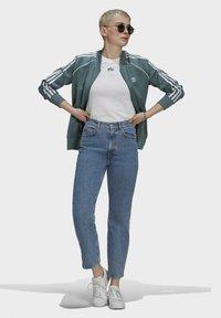 adidas Originals - PRIMEBLUE - Training jacket - green - 1