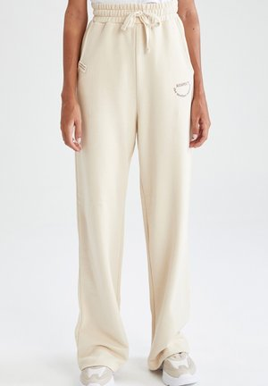 RELAX FIT  - Tracksuit bottoms - ecru