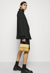 Coccinelle - ARLETTIS - Handbag - warm beige - 0