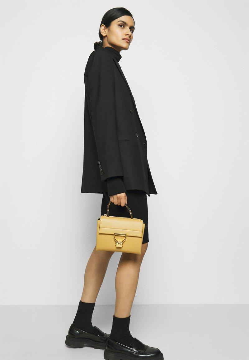 Coccinelle - ARLETTIS - Handbag - warm beige