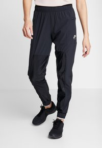 Nike Performance - AIR PANT - Joggebukse - black - 0
