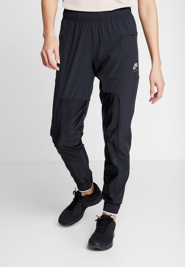 AIR PANT - Verryttelyhousut - black