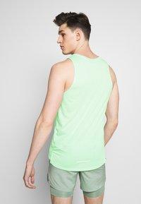 Nike Performance - RISE TANK - Sports shirt - pistachio frost - 2