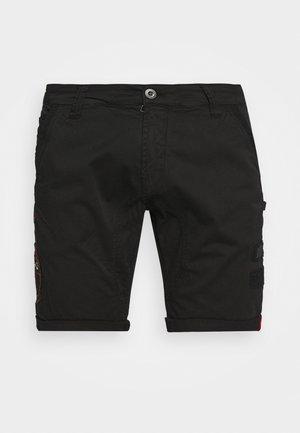 KEROSENE PATCH - Shorts - black